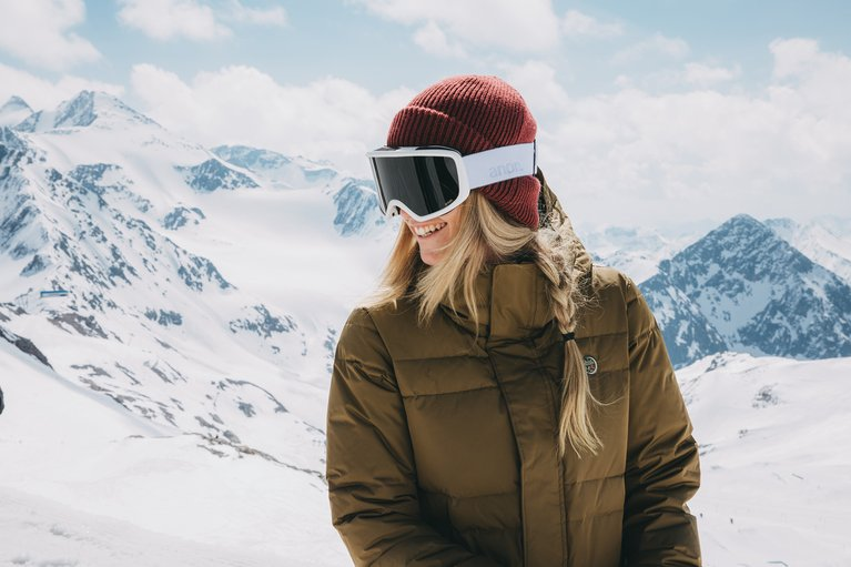 A Snowboarder Wearing a Super Warm Burton Jacket Featuring Responsibly Sourced Down