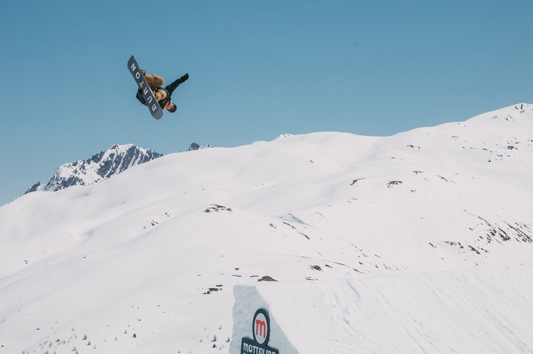 Ben Ferguson hitting a jump on the Burton Custom