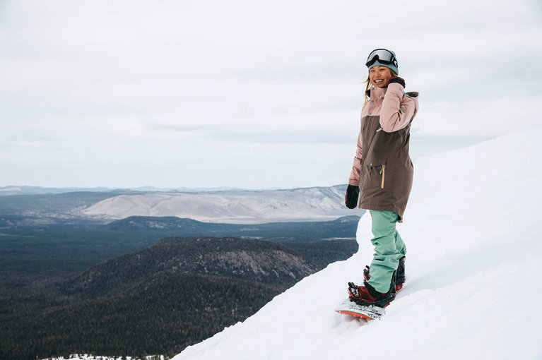 Chloe Kim strapped into her board on snow