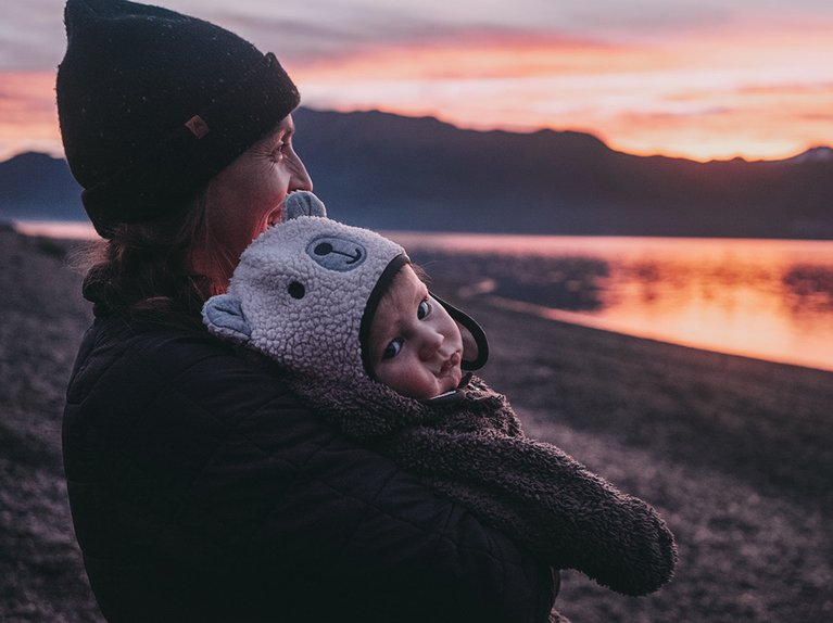 Kimmy Fasani and son Koa watching a sunset in New Zealand