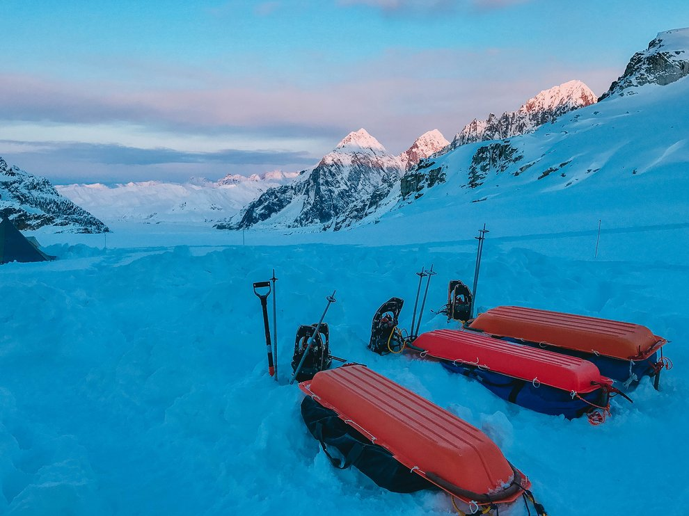 Sleds in front of mountains