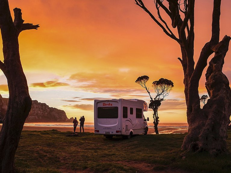 Kimmy Fasani's RV at a beach in New Zealand