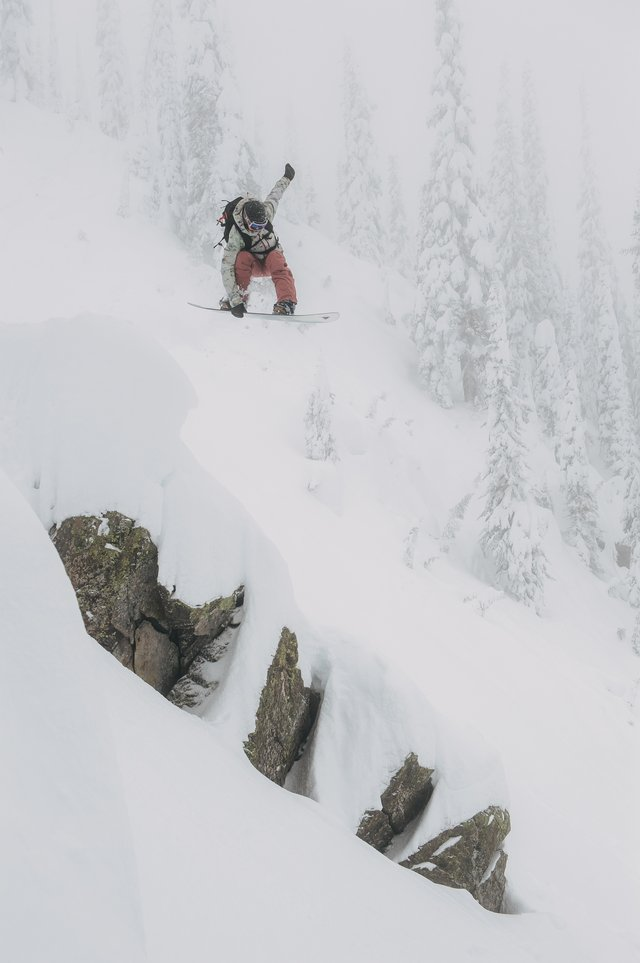 Kelly Clark dropping a cliff in the backcountry.
